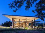 Каркасный дом с витражным остеклением фасада